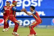 Royal Challengers Bangalore Yuzvendra Chahal with team mates celebrate the wicket of Brendon McCullam