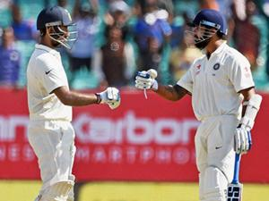 Murali Vijay is congratulated by Cheteshwar Pujara on completion of his half-century