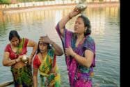 Devotees take holy bath during Chhath Puja Festival in Ranchi