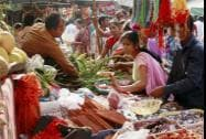 Women purchase vegetables and other things for the 'Chhath Puja' festival in Gurgaon