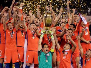 Chile goalkeeper Claudio Bravo and his teammates celebrate with their trophy after the Copa America  2016