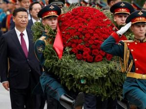Chinese President Xi Jinping attends a wreath laying ceremony