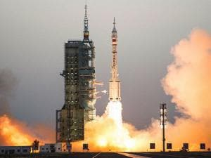 China's Shenzhou 11 spaceship onboard a Long March-2F carrier rocket takes off from the Jiuquan Satellite Launch Center in northwest China