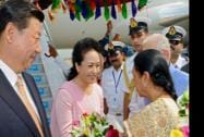 Chinese President XI Jinping and his wife Peng Liyuan being greeted by Gujarat CM Anandiben