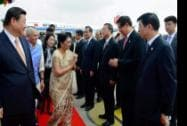 Chinese President XI Jinping looks on as Gujarat CM Anandiben Patel exchange greetings with Chinese officials