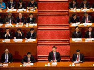 Chinese President Xi Jinping listens to a speech during the opening session