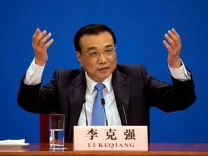 Chinese Premier Li Keqiang speaks at a press conference after the closing session of the National People's Congress
