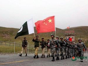 Xinjiang Chinese and Pakistan troops jointly patrolling the border connecting PoK