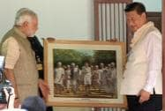 Prime Minister Narendra Modi presents a portrait to Chinese President Xi Jinping at Gandhi Ashram