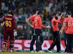 England players celebrates the wicket of Dinesh Ramdin during a ICC WT20 match against West Indies at Wankhede Stadium