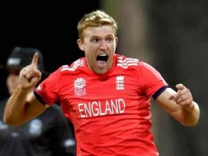 England's David Willy celebrates the wicket of West Indies's Johnson Charles during the ICC T20 World Cup match played in Mumbai