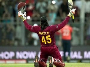 West Indies' Chris Gayle celebrates his century during a ICC WT20 match against England at Wankhede Stadium in Mumbai