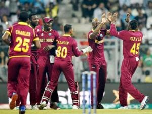 West Indies players celebrate the wicket of England's Jason Roy during a T20 World Cup match at Wankhede Stadium in Mumbai