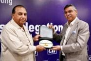 MD of Hero MotoCorp Sunil Kant Munjal presents a memento to S M Muneer, Chief Executive TDAP
