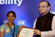 Arun Jaitley presenting  CII Woman Exemplar Award to P Thayammal