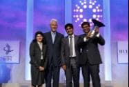 Former President Bill Clinton poses with the winning team from Indian School of Business
