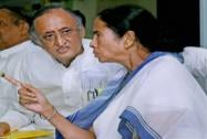 West Bengal Chief Minister Mamata Banerjee talks to State Finance and Industry Minister Amit Mitra