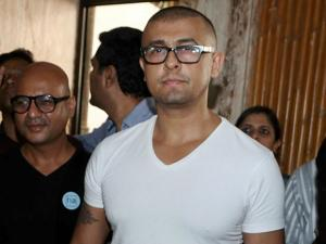 Singer Sonu Nigam at a press conference after he shaved off his head