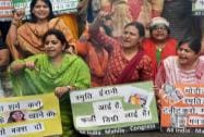 Activists of  Congress women's wing hold placards and raising slogans