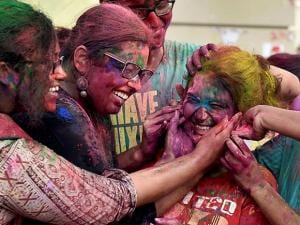 Students of Presidency University celebrate Holi at the University campus in Kolkata