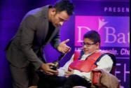 Cricketer M S Dhoni gives the Positive Health Award to the World's Youngest Disabled Patent Holder Hridayeshwar Singh Bhati