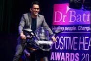 Cricketer M S Dhoni poses on a bike at the Positive Health Awards function
