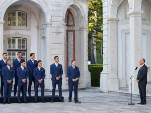 Portuguese President Marcelo Rebelo de Sousa, right, addresses the national soccer team at the Belem presidential palace in Lisbon