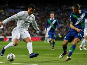 Real Madrid Cristiano Ronaldo fights for the ball against Wolfsburg's Ricardo Rodriguez during the Champions League 2nd leg quarterfinal soccer match between Real Madrid and VfL Wolfsburg