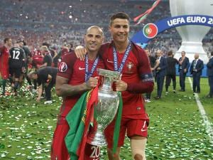 Cristiano Ronaldo holds the trophy with Ricardo Quaresma after the Euro 2016 final