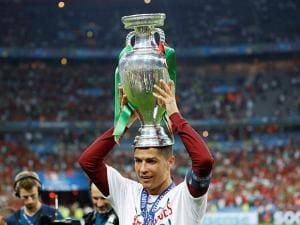 Portugal's Cristiano Ronaldo holds the trophy on his heads at the end of the Euro 2016 final