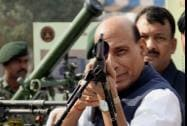 Home Minister Rajnath Singh inspects a weapon during Diamond Jubilee celebrations of Central Reserve Police Force