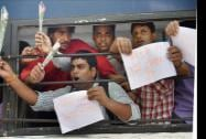 IAS aspirants shout slogans after being detained by police