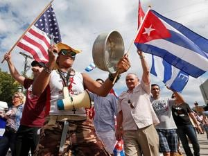 Banging pots and pans and waving Cuban and American flags members of the Cuban community react to the death of Fidel Castro