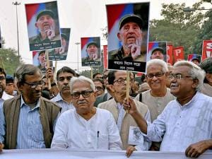 Left Front chairman Biman Bose, CPI(M) state secretary Surya Kanta Mishra and other Left party leaders during a rally to pay respect to Cuban leader Fidel Castro in Kolkata
