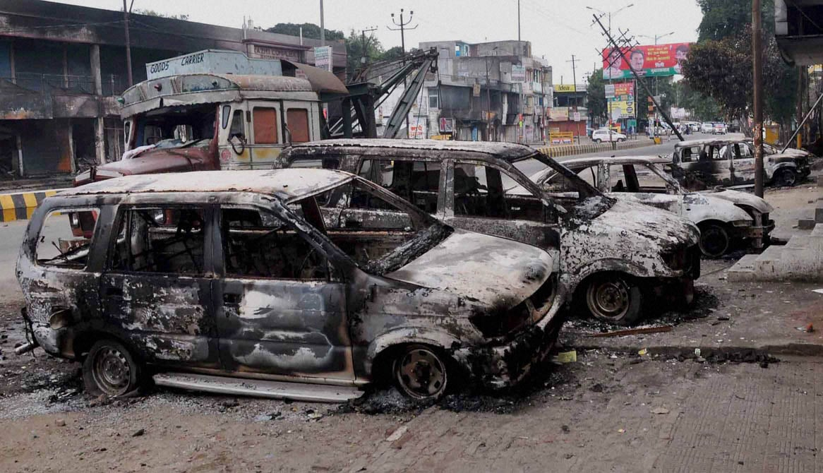 Cars burnt, clashes,two communities,day, before, removed, crane, Saharanpur