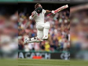 David Warner jumps in the air to celebrate making 100 runs against Pakistan