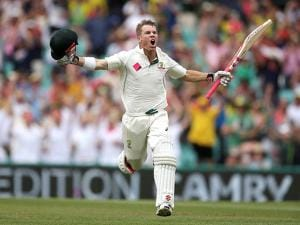 David Warner raises his arms to celebrate making 100 runs against Pakistan