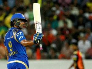 Mumbai Indian's Ambati Rayudu raises his bat after scoring fifty runs against Sunrisers Hyderabad during Indian Premier League (IPL) 2016 T20 match in Hyderabad