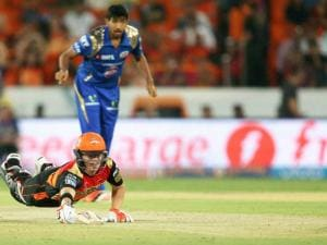 Sunrisers Hyderabad captain David Warner dives to safely make his ground during Indian Premier League (IPL) 2016 T20 match against Mumbai Indians  in Hyderabad