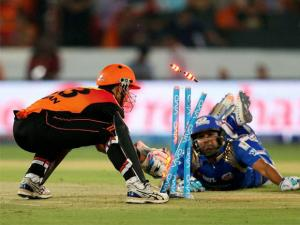 Sunrisers Hyderabad's wicketkeeper Naman Ojha  breaks the wickets to run out Mumbai Indians captain Rohit Sharma  during Indian Premier League (IPL) 2016 T20 match in Hyderabad