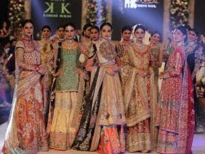 Pakistani models present creations by the House of Kamiar Rokni