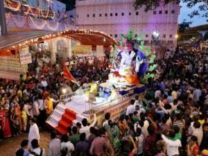 People take part in the Lord Ganesh procession