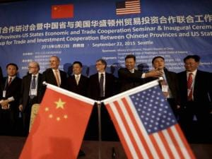 Bill Gates stands with Zhang Xiangchen to his right, China's deputy for international trade and other officials