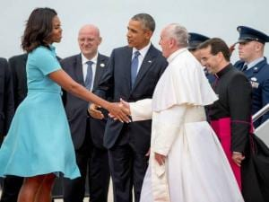 First lady Michelle Obama, accompanied by President Barack Obama, greet Pope Francis