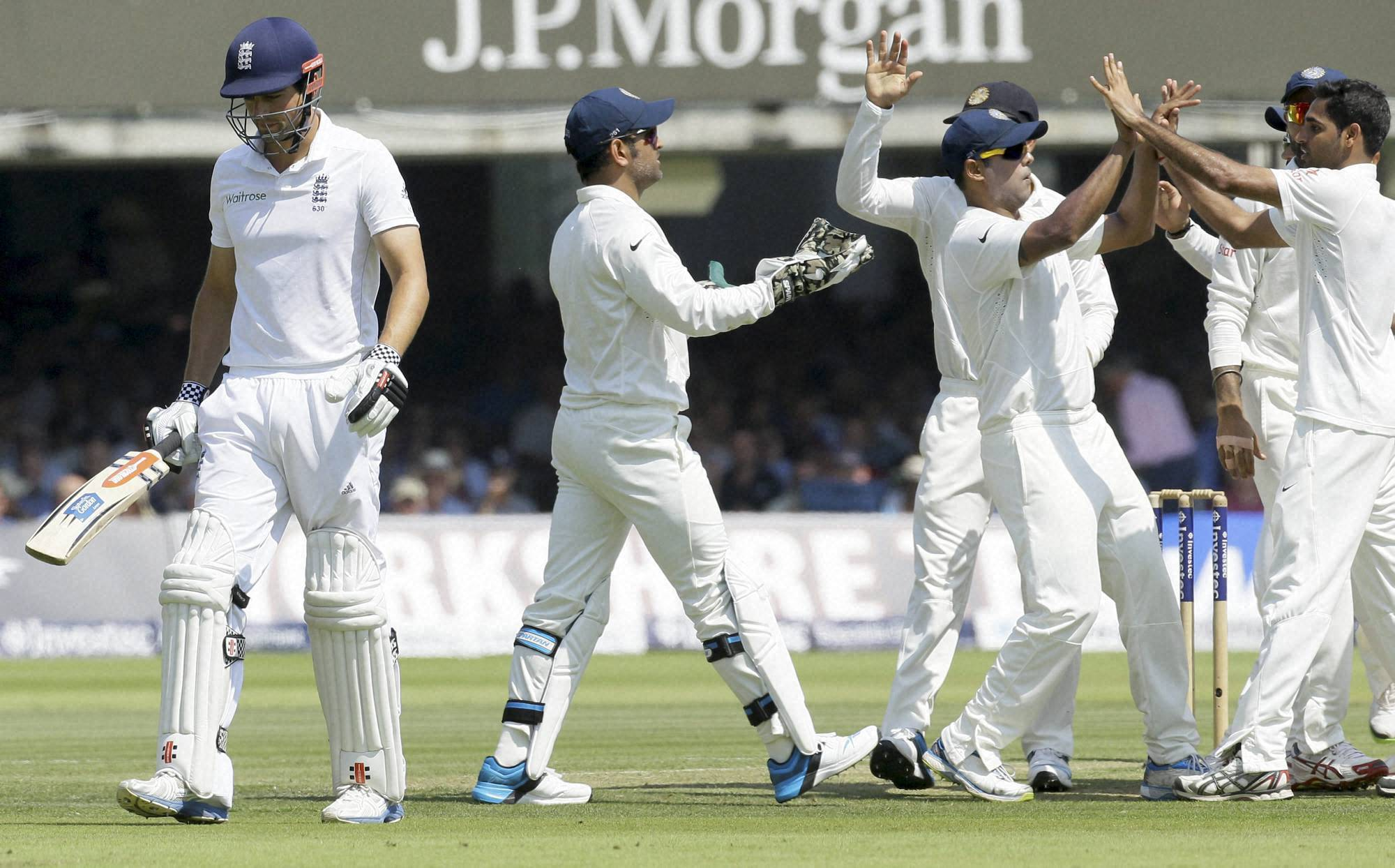 India's, players, celebrate, wicket, England's, captain, Alastair Cook, second day, test match, England, India Lord's, cricket, London