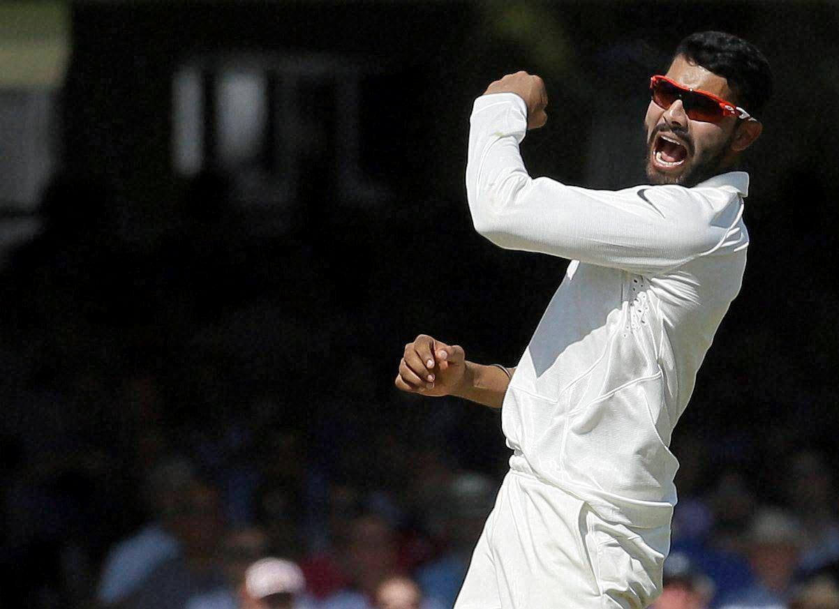 Joe Root, plays, shot off, Stuart Binny, Ishant Sharma, India's, Ravindra Jadeja, fails, stop ball,England's, Ian Bell, India's, Bhuvneshwar Kumar, second day, second test match, England, India, Lord's, cricket, London