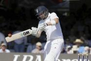 England's Joe Root plays a shot off the bowling of India's Stuart Binny
