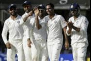 India's Bhuvneshwar Kumar celebrates with teammates the wicket of England's Gary Ballance