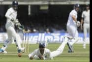 India's Ravindra Jadeja fails to stop a ball from England's Ian Bell played off the bowling