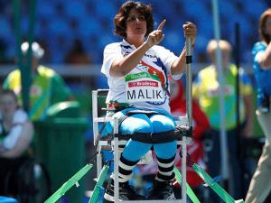 Deepa Malik gestures as she competes in the women's final shot put